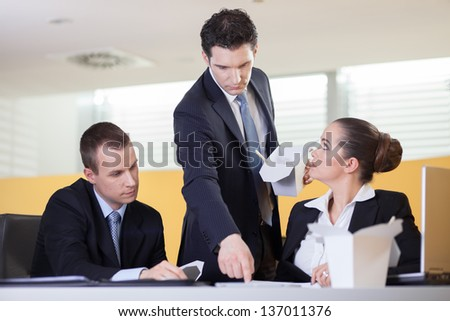 Annoying supervisor giving his coworkers a hard time during lunch break - stock photo