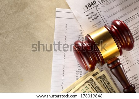 Annual budget, tax form, gavel and dollars - stock photo