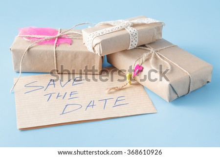 Annual date invitation card. Present box and message save the date - stock photo