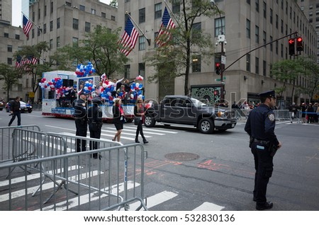 Annual Pulaski Polish day parade in Manhattan. Police officers in foreground guarding - October 2, 2016, 5th Avenue, New York City, NY, USA