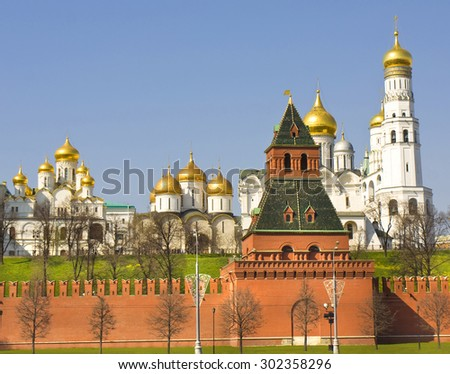 Annunciation, Assumption and Archangel cathedrals, bell tower Ivan the Great and Tayninskaya tower of Moscow Kremlin. - stock photo