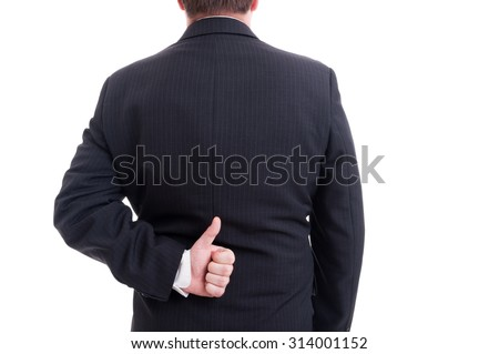 Anonymous businessman showing like with the hand behind back isolated on white - stock photo