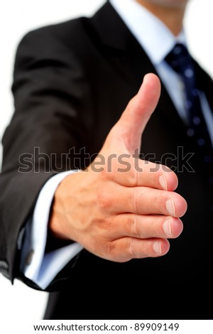 Anonymous caucasian man in business suit offers his hand as a congratulatory gesture