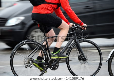 Anonymous people on bikes - stock photo