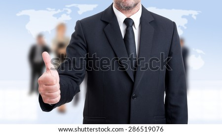 Anonymus business man showing like on business people background - stock photo