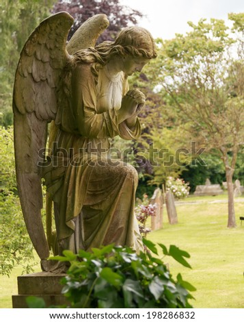 Another angel in full colour and soft background - stock photo
