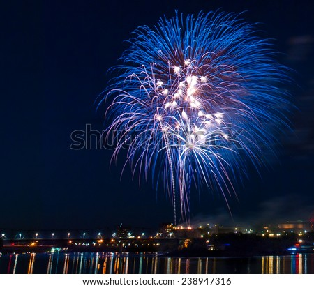 Another fireworks celebration for the anniversary party on the country's birthday. - stock photo