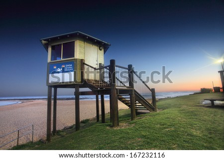 Another perfect day draws to a close.  This is the lifeguard's lookout tower at Toowoon Bay, Australia at dusk - long exposure - stock photo