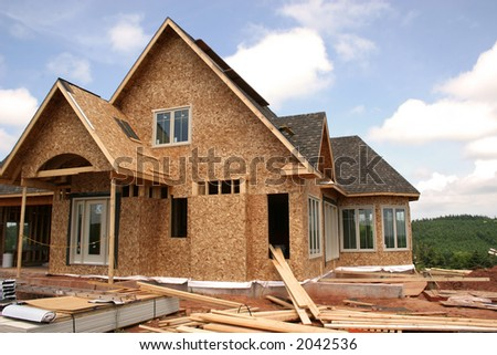 Another view of a house under construction. - stock photo