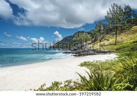 Anse Cimitiere beach surrounding by an amazing lava rock formations, Silhouette island,  Seychelles - stock photo