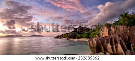 Anse Source d'Argent beach panorama at twilight, La Digue, Seyshelles - stock photo