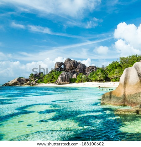 Anse Sous d'Argent beach with granite boulders and turquoise sea - stock photo