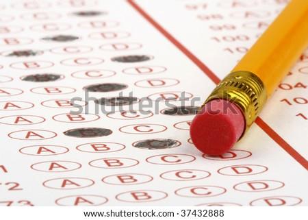 Answer sheet pencil eraser - stock photo