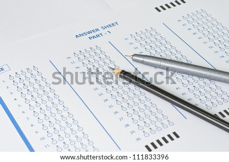 Answer Sheet with pen and pencil - stock photo