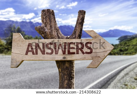 Answers wooden sign with a street background  - stock photo