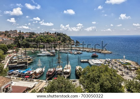 ANTALYA, TURKEY - MAY 29, 2017: Old marina is most popular tourist place, cozy cafes, luxury restaurants, green park, landmarks and fascinating trips wait the visitors in port Antalya.