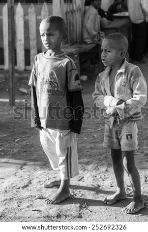 ANTANANARIVO, MADAGASCAR - JULY 2, 2011: Unidentified Madagascar kids in the street. People in Madagascar suffer of poverty due to slow development of the country