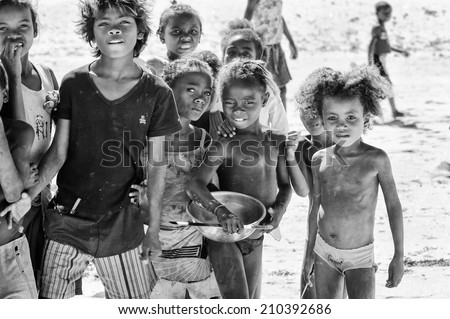 ANTANANARIVO, MADAGASCAR - JULY 3, 2011: Unidentified Madagascar smiling children pose for the camera. People in Madagascar suffer of poverty due to slow development of the country - stock photo