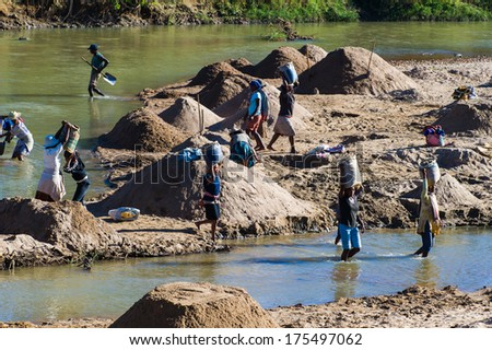 ANTANANARIVO, MADAGASCAR - JUNE 29, 2011: Unidentified Madagascar people take water from the river. People in Madagascar suffer of poverty due to the slow development of the country - stock photo