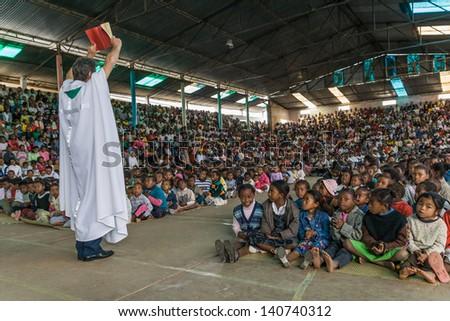 ANTANANARIVO, MADAGASCAR, OCT 07: Father Pedro Opeka during his mass in his village of Akamasoa, Antananarivo, Madagascar on oct 07, 2007. Father Pedro is nominated for Nobel Peace Prize 2013. - stock photo