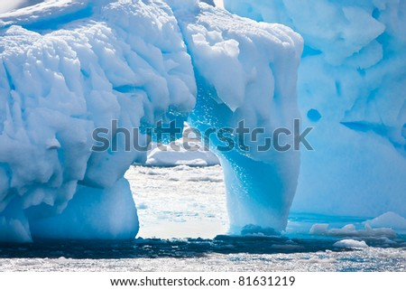 Antarctic glacier in the snow. Beautiful winter background. - stock photo