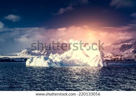 Antarctic Glacier with cavities. Beautiful winter background. - stock photo