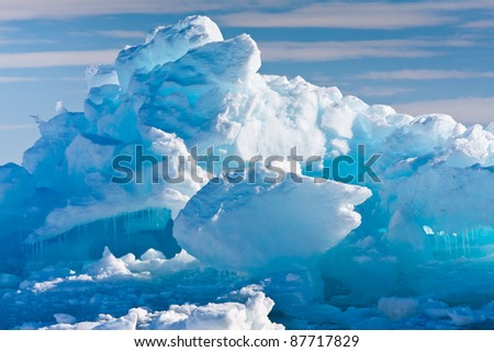 Antarctic Glacier with cavities. Beautiful winter background. - stock photo