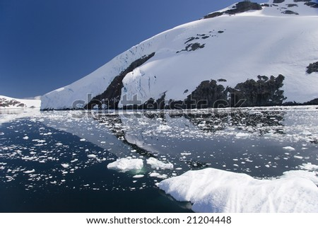 Antarctic reflections in the still Lemaire Channel - stock photo