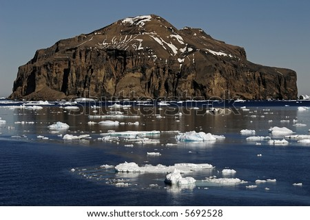 Antarctic rocky island - stock photo