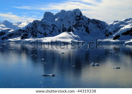 Antarctic view of icy peaks and reflections in Paradise Harbor - stock photo
