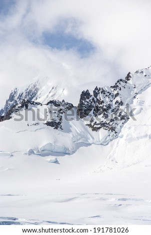 Antarctica - Antarctic Peninsula - Palmer Archipelago - Neumayer Channel - Global Warming - Fairytale Landscape / Antarctica - Snow And Clouds - stock photo