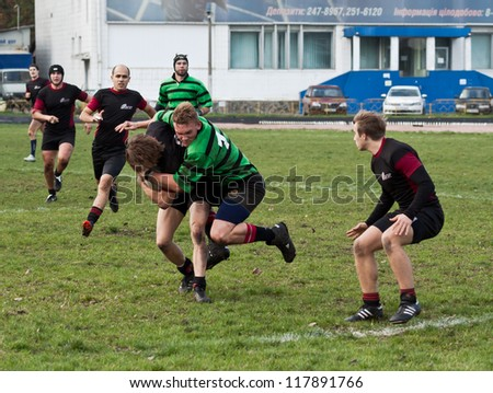 ANTARES - EGER, UKRAINE, KIEV - NOVEMBER 4 : Unidentified rugby players in action at a Ukrainian National Championship Final rugby match, Antares(in green) vs. Eger(in black), November 4, 2012 in Kiev, Ukraine. - stock photo