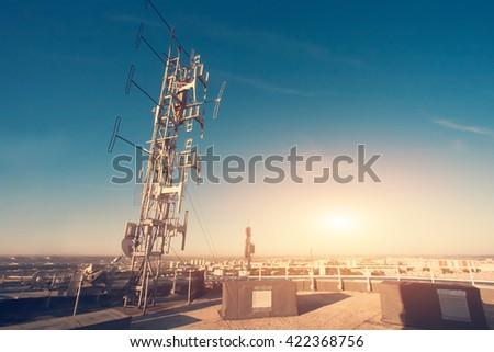 Antenna against the blue sky - stock photo