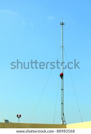 Antenna  alert on blue sky - stock photo