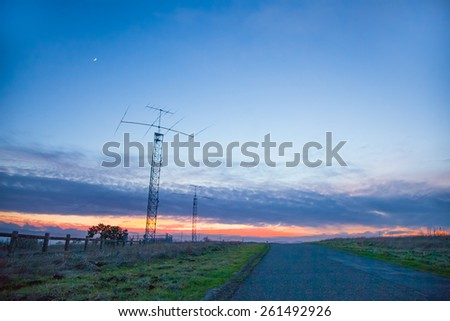 Antenna in a field.  Stanford dish.  Wireless communications. - stock photo