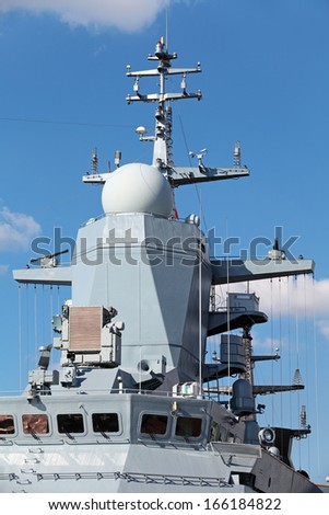 Antenna of the radar and other equipment on the deck of a modern military ship - stock photo