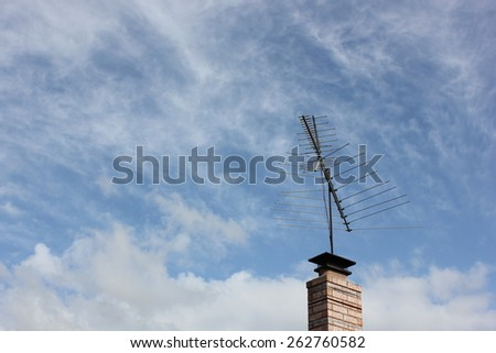 Antenna on Brick Chimney with sky background - stock photo