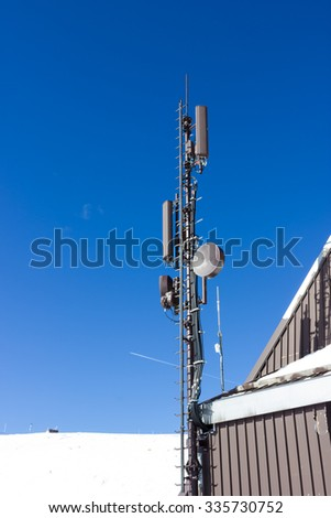 Antennas and repeaters - stock photo