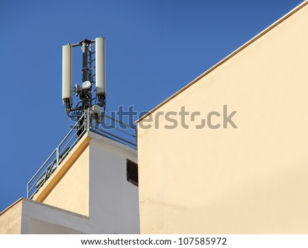 Antennas for mobile devices mounted on the building - stock photo