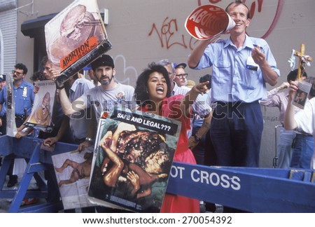 Anti-abortion activists chanting with graphic posters, New York - stock photo