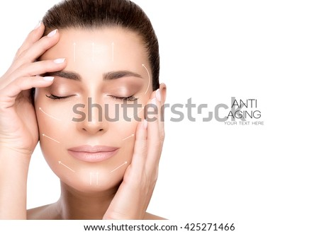 Anti aging treatment and plastic surgery concept. Beautiful young woman with hands on cheeks and eyes closed with a serene expression in a beauty, skincare and spa concepts. Portrait isolated on white - stock photo