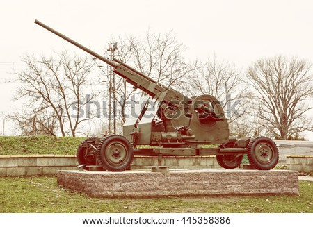 Anti-aircraft machine gun of the WwII. Biggest war campaign of 20th century. Yellow photo filter. Weapons theme. Exposed artillery.