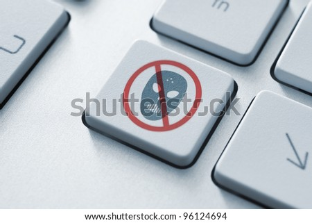 Anti raiders attack key on the keyboard. Toned Image. - stock photo