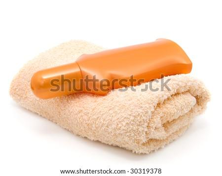 anti-sun cream and bath towel - stock photo
