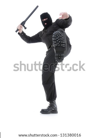 Anti-terrorist police guy wearing black uniform and black mask making a kick, shot on white - stock photo