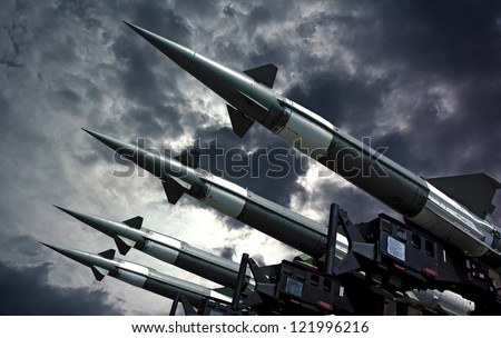 Antiaircraft rockets on the launcher against dramatic sky. - stock photo