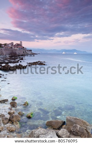 Antibes looking towards the Old Town and Nice in the horizon - stock photo