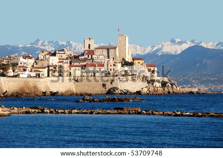 Antibes, old town, French Riviera. The tower with the flag is the first museum in the world to be dedicated to the artist Pablo Picasso. - stock photo