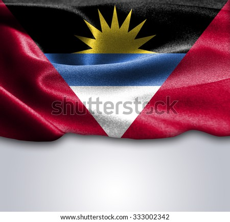 Antigua and Barbuda flag on smooth silk texture Space for Text