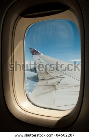 ANTIGUA - AUGUST 17: Virgin Atlantic Airways, Boeing 747 wing during flight on August 17, 2011 in Antigua. Operates from Heathrow and Gatwick, owned by Sir Richard Branson and Singapore Airlines - stock photo